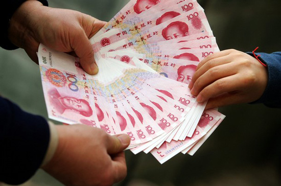 A Chinese vendor displays notes during a